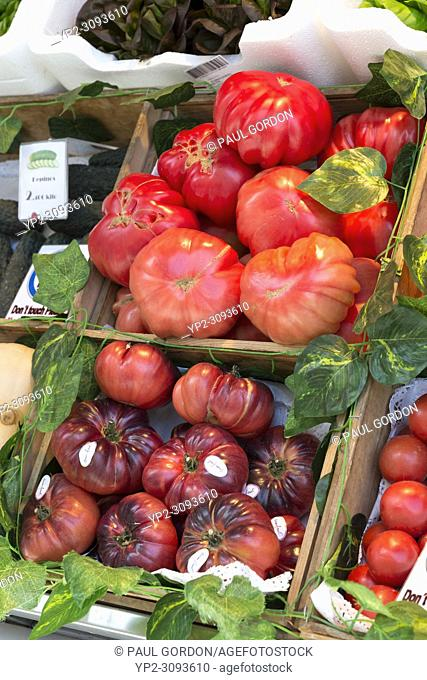 Madrid, Spain: Fresh heirloom tomatoes for sale at Mercado de San Miguel. Originally built in 1916, the landmark building was renovated and reopened it in 2009...