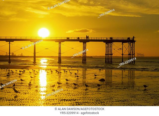 Saltburn by the sea, North Yorkshire, England. United Kingdom. The sun sets behind Saltburn`s Victorian pier; the last remaining pier on the Yorkshire coast