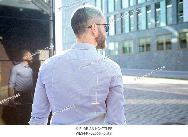 Businessman in the city looking around