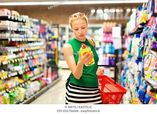 Beautiful caucasian woman shopping cleaners at supermarket