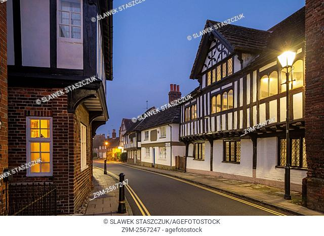 Night falls on Church Street in Steyning, West Sussex, England