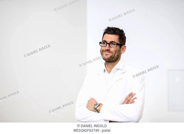 Portrait of smiling man wearing work coat
