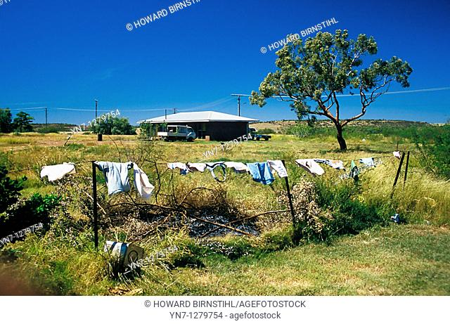 Washing drying on the fence of outback property