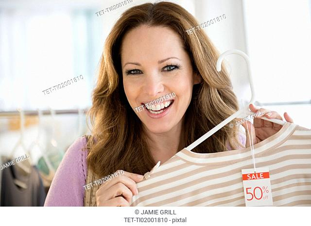 Portrait of woman doing clothes shopping