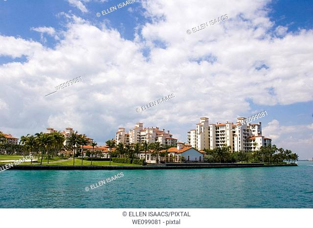 Ultra expensive luxury condominums on exclusive Fisher Island as seen from Biscayne Bay in Miami, Florida