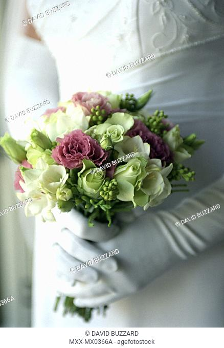 Close up of wedding bouquet held by bride