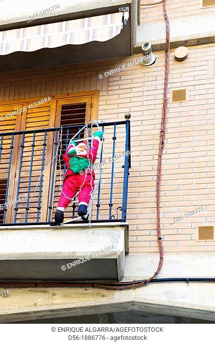 Santa Claus climbing a Balcony, Valencia, Spain