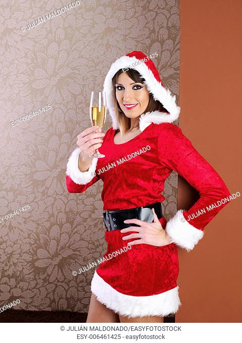 Young woman dressed in Mama Claus with a glass of champagne