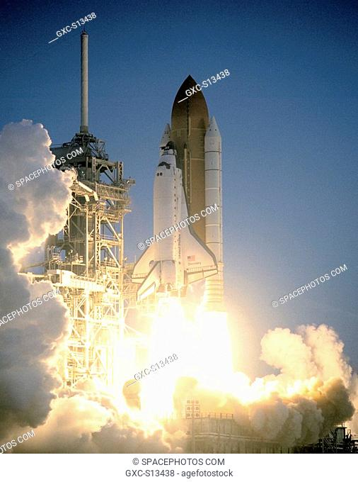 05/27/1999 -- Space Shuttle Discovery lifts off from Launch Pad 39B in a blaze of light amid billows of smoke and steam. With a crew of seven