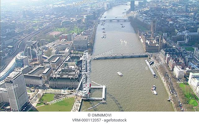 Aerial view of Millennium Wheel and River Thames facing West and panning left