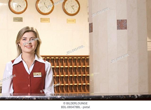 portrait of smiling young receptionist at hotel