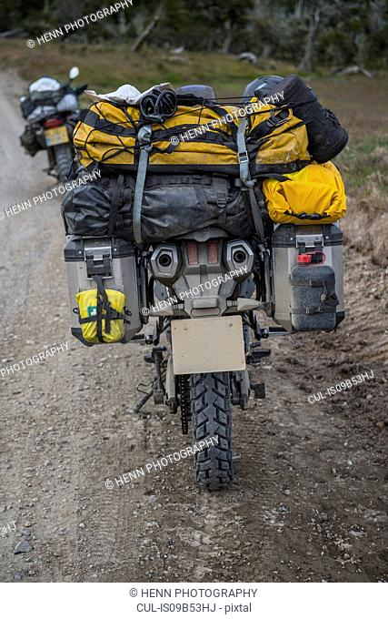 Heavily packed touring motorbike on dirt road, Tierra del Fuego, Argentina