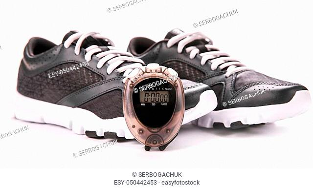 Running Shoes and stopwatch. sport. running shoes for health and exercise
