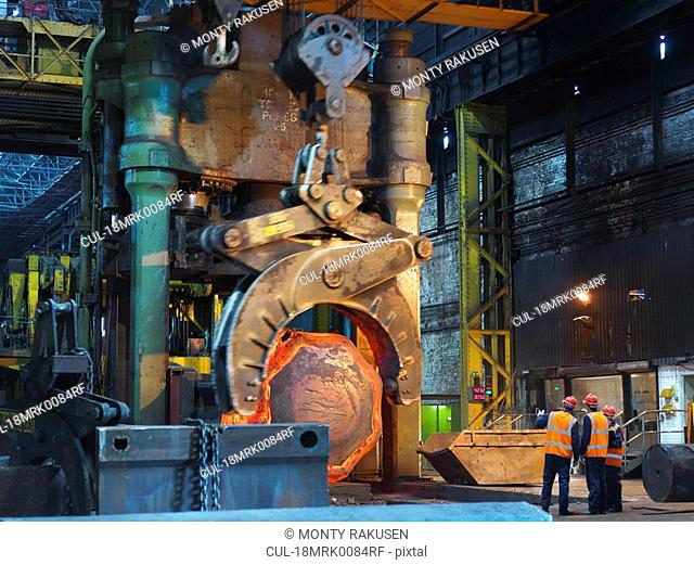 Hot Steel Moving Into Forging Machine
