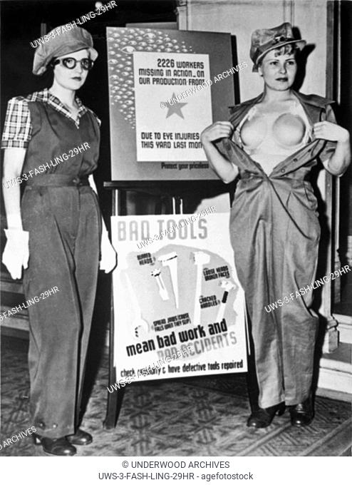 Los Angeles, California: 1943 New Department of Labor safety garb developed for women war time workers. The uniform at the left is worn over the plastic 'bra'...