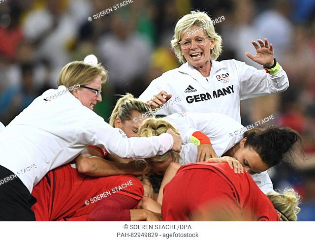 German women soccer team coach Silvia Neid (R) celebrates after her team won the Women's soccer Gold Medal Match between Sweden and Germany during the Rio 2016...