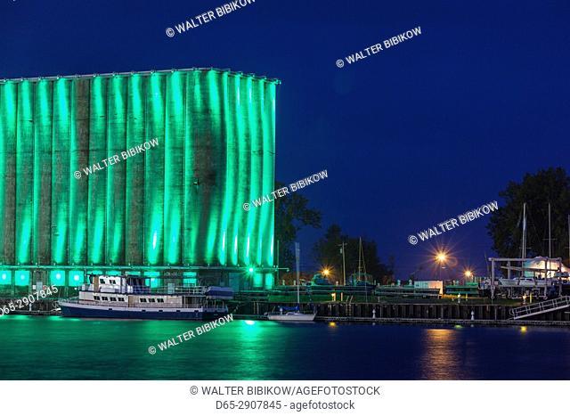 USA, New York, Western New York, Buffalo, Canalside Park, renovated former industrial area, illuminated grain elevator