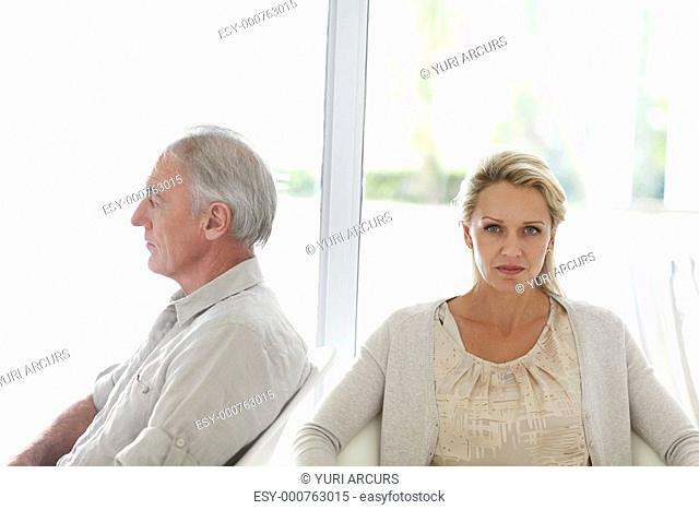 Relationship issues - Mature couple sitting in different directions