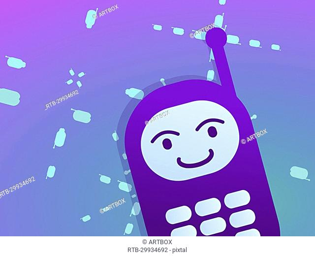Close-up of a mobile phone with a smiley face on it