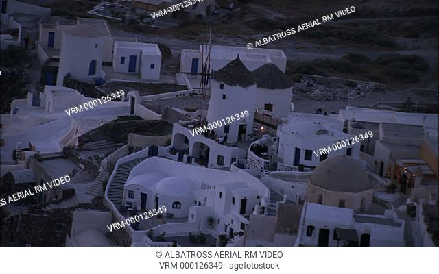 Aerial HD video of Oia Island village, part of Santorini, in twilight time