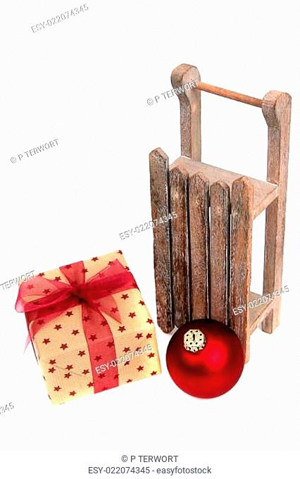 old wooden sledge with present on white