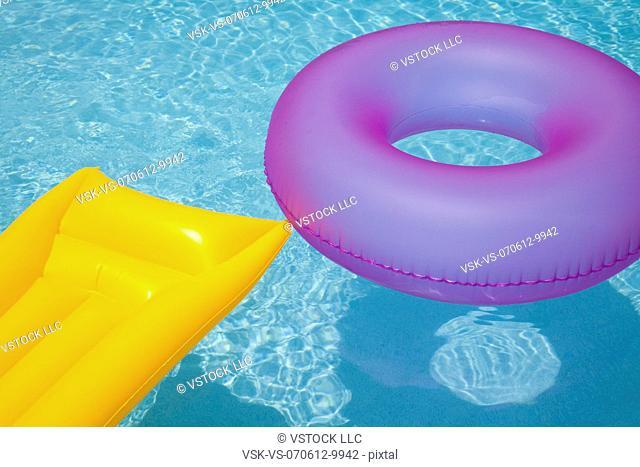 USA, Florida, St. Petersburg, Inner tube and pool raft floating on water