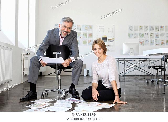 Portrait of two colleagues in an office