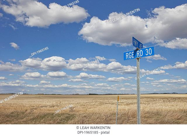 signs of two intersecting roads, alberta canada