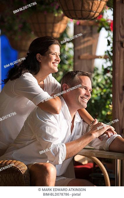 Smiling Caucasian couple in restaurant