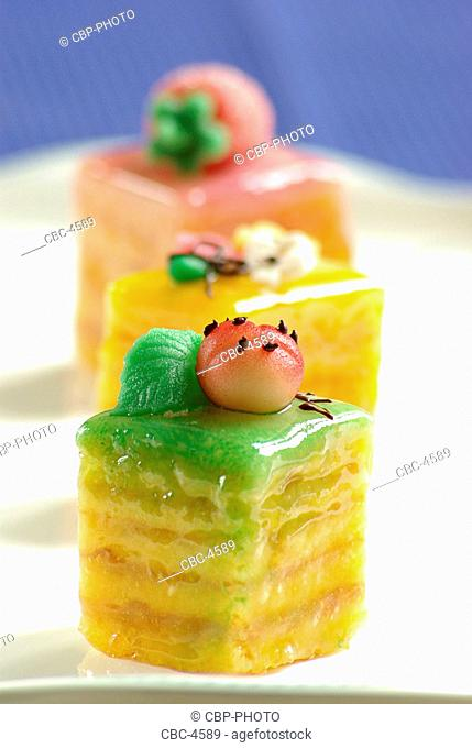 Nicely Decorated Petit Fours On A Plate