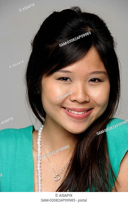 Head shot of young woman smiling