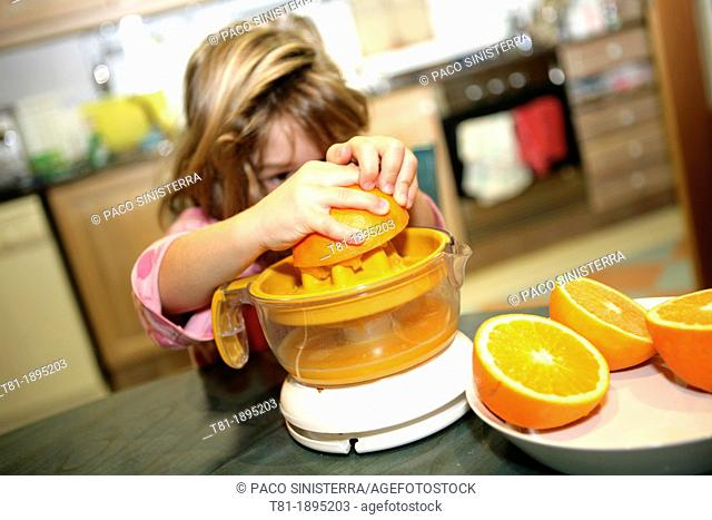 Girl preparing orange juice