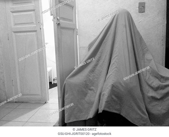 Girl Under Sheet Looking like Ghost