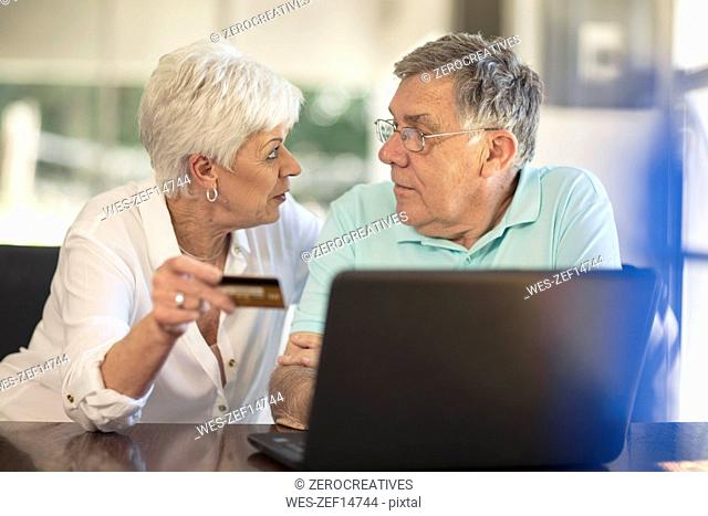 Senior couple shopping online with credit card