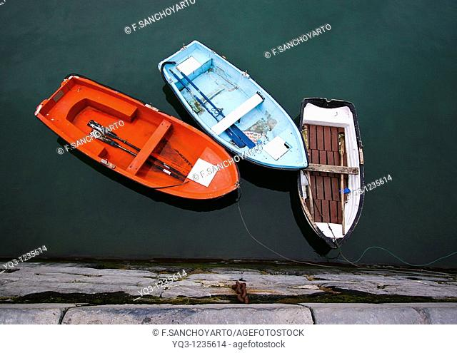 Auxiliar boatsalongside dock. Port of Castro Urdiales , Cantabria, Spain