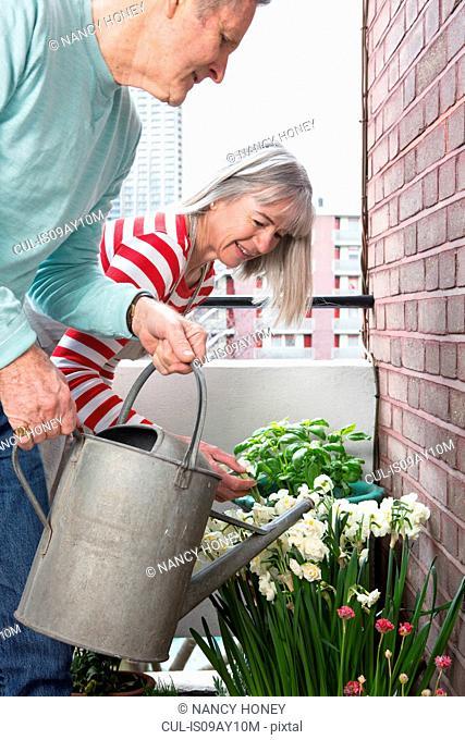 Couple gardening on balcony
