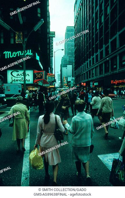 People walking down State Street, one of the main streets in Downtown Chicago, Illinois, October, 1973. Image courtesy John White/US National Archives