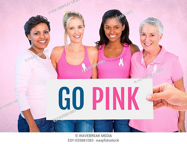 Go Pink Text and Hand holding card with pink breast cancer awareness women