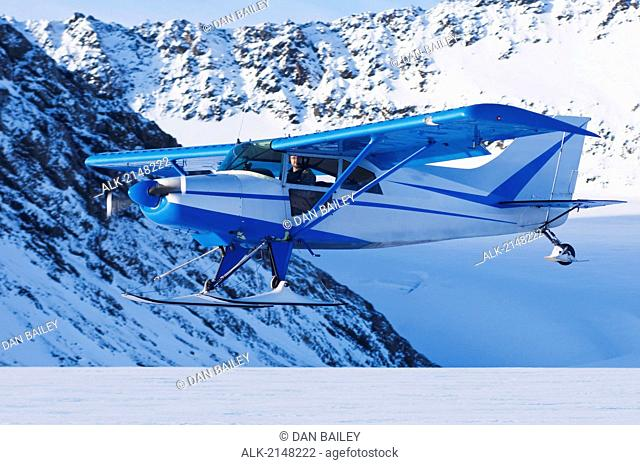 Pilot Flying Low Over The Eagle Glacier In A Maule Ski Plane In The Chugach Mountains, Southcentral Alaska, Winter
