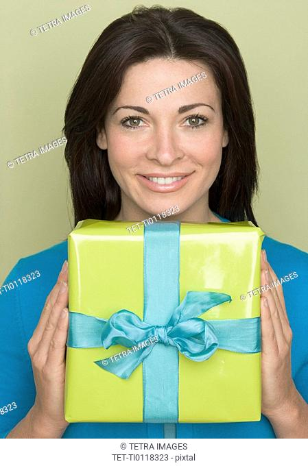 Woman holding wrapped present