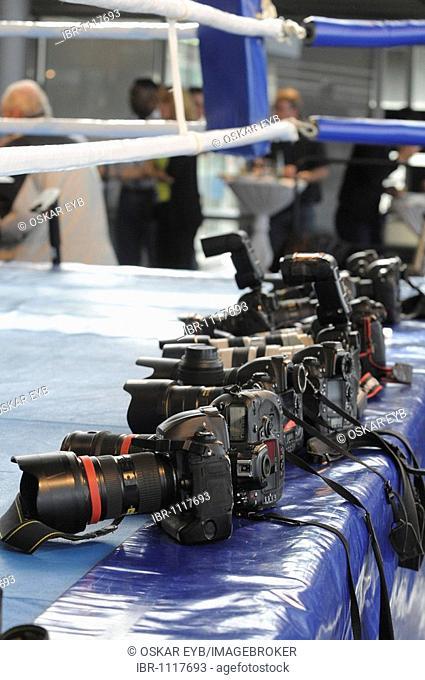 Digital single-lens-reflex cameras belonging to professional sport photographers laying at the ready on ringside, Stuttgart Bad-Cannstatt, Baden-Wuerttemberg