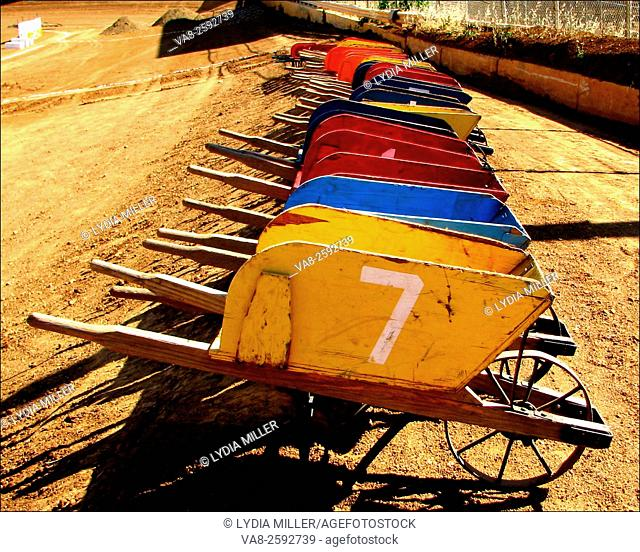 Multi colored wood wheelbarrows are lined up for the Johnny Studebaker Race at the El Dorado County Fairgrounds in Placerville, California