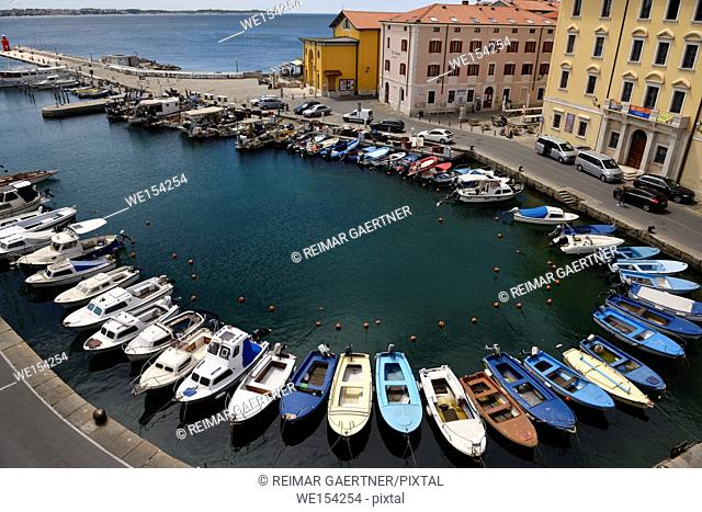 Horseshoe pattern of moored boats at the inner harbour of Piran Slovenia on the Adriatic Sea coast