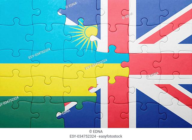 puzzle with the national flag of great britain and rwanda . concept