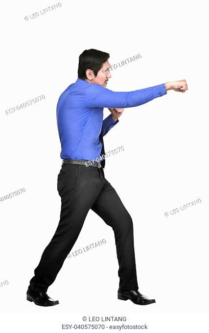 Portrait of asian businessman punching something posing isolated over white background