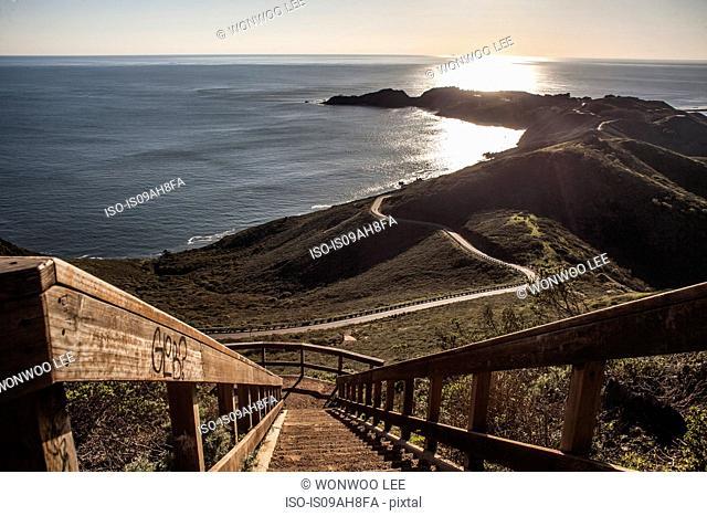 View of coastal staircase and sea at sunset, San Francisco, California, USA