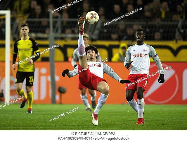 08 March 2018, Germany, Dortmund: Europa League match between Borussia Dortmund and RB Salzburg, Signal Iduna Park: Salzburg's Andre Ramalho (C) performing an...