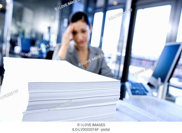 Businesswoman looking stressed in a contemporary office