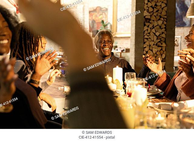 Happy multi-generation family enjoying Christmas dinner