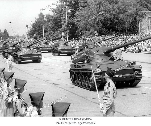 "Tanks roll past the spectators during the parade on the occasion of the French national day on the 14th of July in 1960 in the headquarters """"Quartier..."